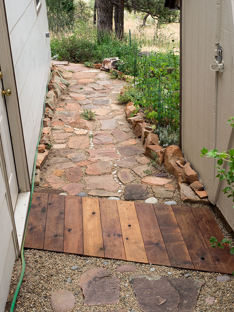 Small cedar walkway between our garage and our shed