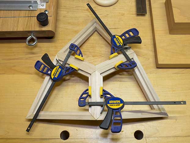Three deltoids clamped together
