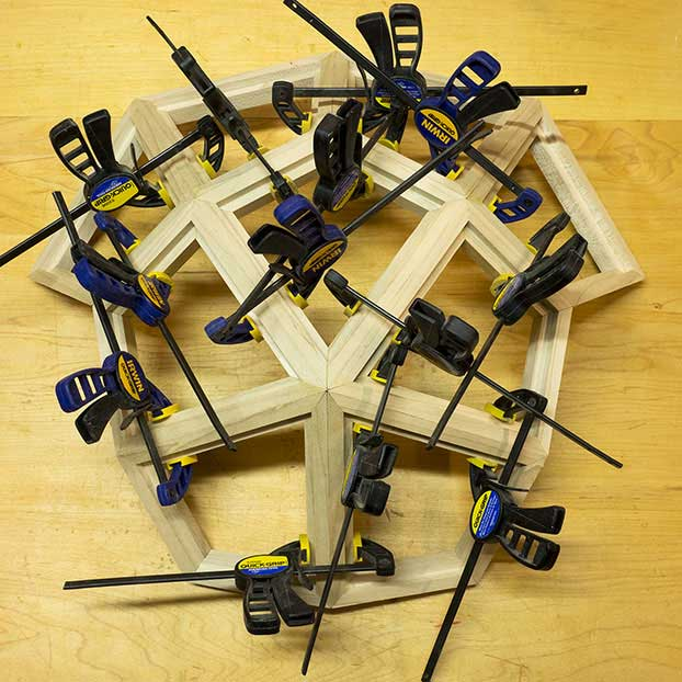 Nine deltoids clamped together